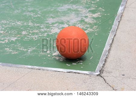 Old outdoor basketball court with the ball