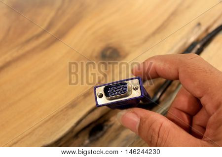 VGA tech pc input cable connector isolated on wood background