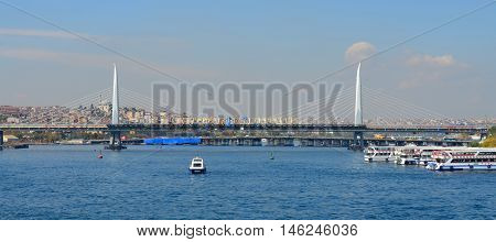 ISTANBUL,TURKEY OCTOBER 5: Eminonu Port near Yeni Cami and Galata Bridge on Oct 5, 2013 in Istanbul,Turkey. The Eminonu waterfront is a major dock for ferryboats in Istanbul.
