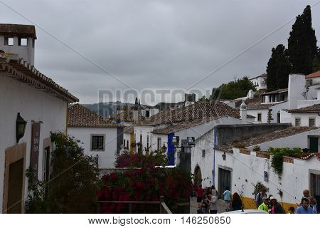 OBIDOS, PORTUGAL - AUG 24: Town of Obidos in Portugal, as seen on Aug 24, 2016. It remains a well-preserved example of medieval architecture; its streets, squares, walls and its castle are a popular tourist destination.