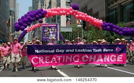 New York City - June 25 2005: National Gay and Lesbian Task Force marchers with banner and balloons at the 2005 Gay Pride Parade on Fifth Avenue