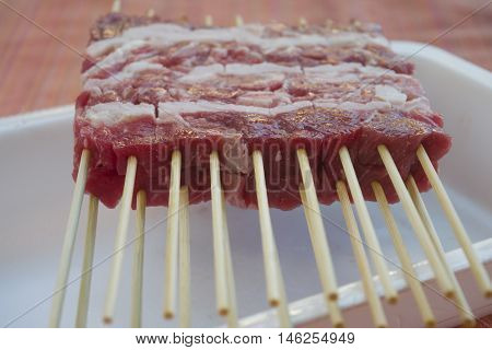 arrosticini or castrated sheep's meat (mutton) cut in chunks and pierced by a skewer