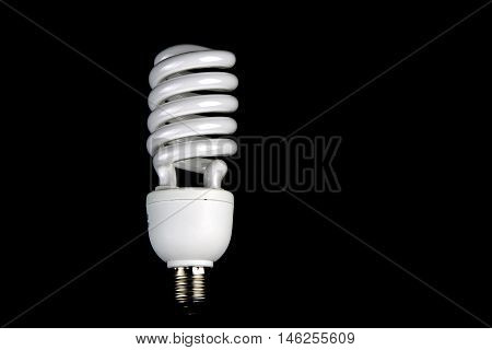 Energy efficient lamp isolated against a black background