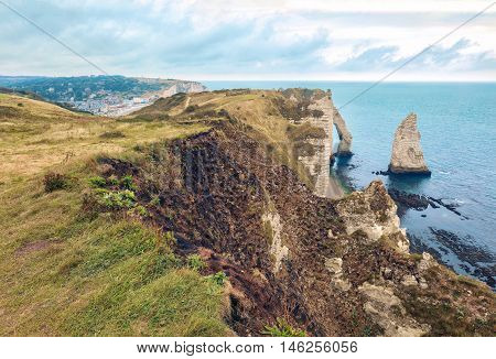 Etretat steep arch shaped cliff at low tide, view from above, Normandy, France
