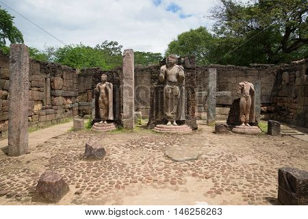 POLONNARUWA, SRI LANKA- MARCH 15, 2015: Ancient sculpture of standing Buddha the ruins of the temple Hatadage. Historical landmark