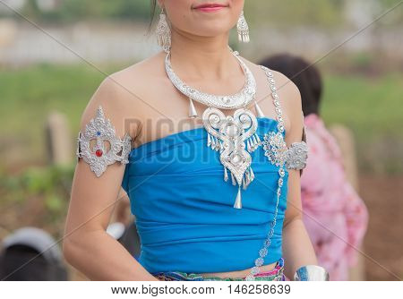 Asian lady in thai local dress in wax festival.