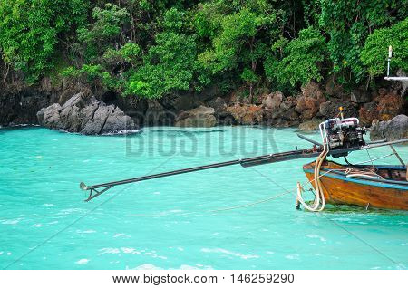 A primitive outboard motor used to power wooden boats in and around the PhiPhi Islands on the Andaman Sea in Thailand.