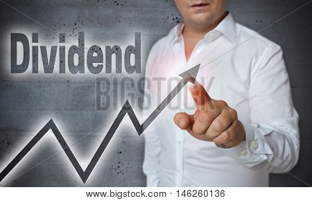 Dividend touchscreen is operated by man concept
