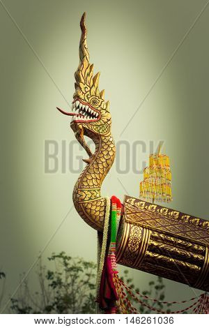 Head of naka statue on Thai style Rocket Boon Bang Fai festival Thailand vignetting