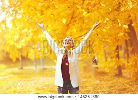 Leaf Fall, Happy Expression Young Woman Having Fun In Warm Sunny Autumn Forest