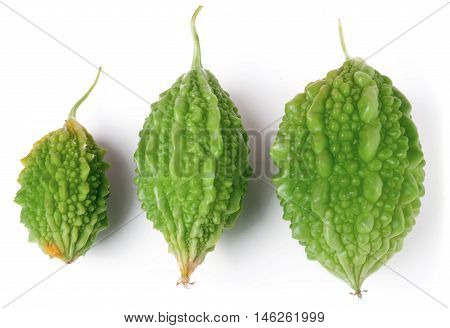 three green bitter melon or momordica isolated on white background.