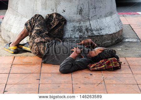 Homeless Man Sleep On Pavement