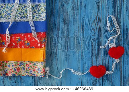 Items for sewing or DIY on blue wooden table