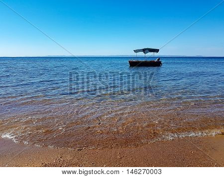 An isolated boat waiting to get someone onboard