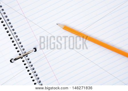 blank notebook paper and a yellow pencil