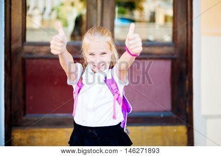 Schoolgirl In School Uniform Showing Thumbs Up
