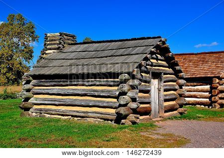Valley Forge Pennsylvania - October 15 2015: Wooden log cabins housed Continental Army soldiers during the 1787-88 Revolutionary War winter encampment at Valley Forge *