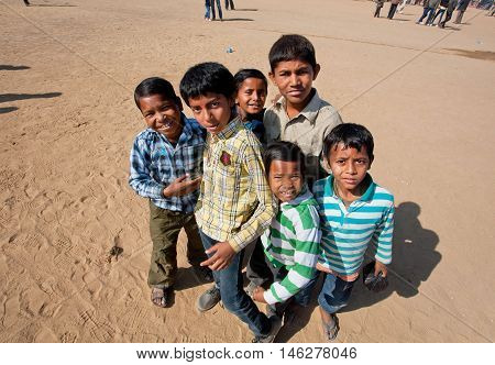 JAISALMER, INDIA - MAR 1, 2015: Unidentified children curiously looking around during the popular Desert Festival  in Jaisalmer city, India. Every winter Jaisalmer takes the Desert Festival