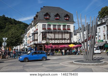 BOUILLON BELGIUM - AUG 13 2016: Belgian medieval city along river Semois in Ardennes with tourists relaxing in the centre of the city on August 13 2016 in Bouillon Belgium