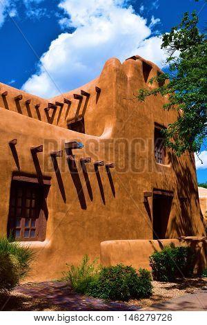 Southwest adobe style building beside a garden taken in Santa Fe, NM
