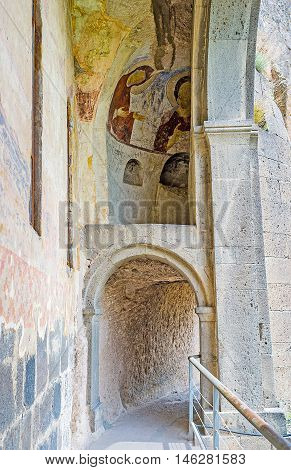 VARDZIA GEORGIA - MAY 27 2016: The narrow hall in front of Dormition church located in medieval monastic complex carved in rocky on May 27 in Vardzia.