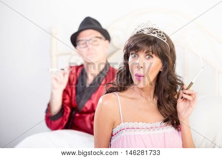 Smoking Puzzled Princess And Playboy Portrait In Bed