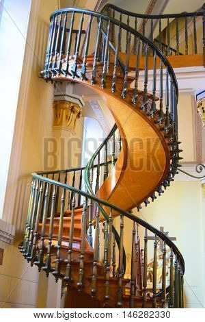 August 29, 2016 in Santa Fe, NM:  Historic spiral staircase with 360 degree turns completed in 1878 taken at the Loretto Chapel where people can have formal events like weddings and using the staircase as a backdrop in Santa Fe, NM