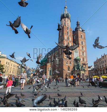 KRAKOW, POLAND - SEP 7, 2016: Main Market Square, is the principal urban space located at center of city. 13th century, and at roughly 40,000 m2, is one of the largest medieval town squares in Europe.