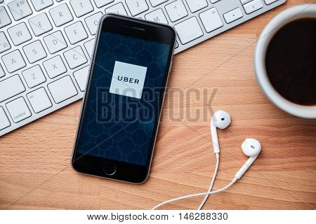 Bangkok,Thailand - June 15, 2016: Apple iPhone with UBER application on the screen. UBER is a smartphone application that allows the passenger to submit a trip request to UBER drivers