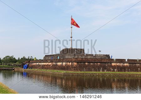 The flag tower at the citadel at the Forbidden City in Hue Vietnam. This fortress and palace complex started construction in 1805 by Emperor Gia Long.