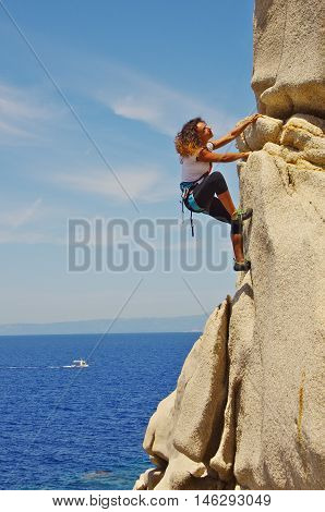 Attractive Young Woman Climbing