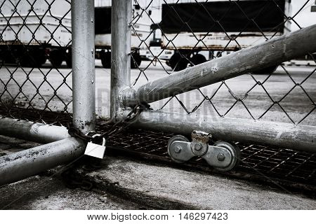 Wire mesh fence enclosing by key vintage tone