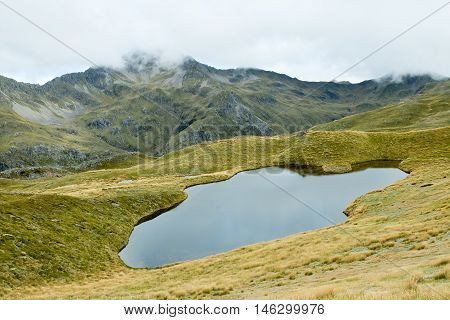 Alpine Tarn on the Lewis Pass Tops Route.  Lewis Pass, Southern Alps, New Zealand