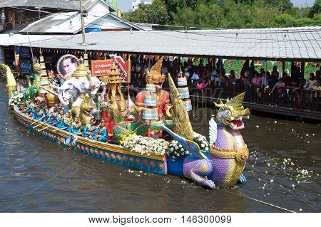 SAMUT PRAKAN,THAILAND - OCTOBER 26,2015 : people enjoy the Lotus throwing procession by the river ceremony on End of Buddhist Lent Day in Rub Bua Festival ,Samut Prakan Province, Middle of Thailand.