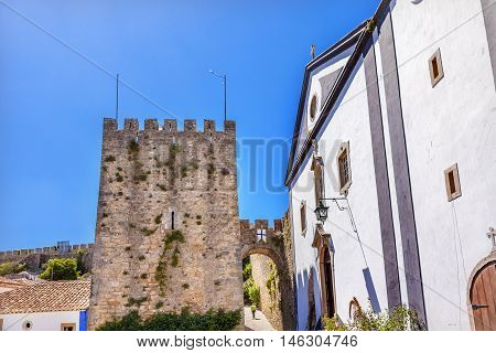 Sao Pedro Church Turret 11th Century Medieval Town Obidos Portugal. Church built in the late 13th/early 14th century. Castle and walls built in 11th century after town taken from the Moors.