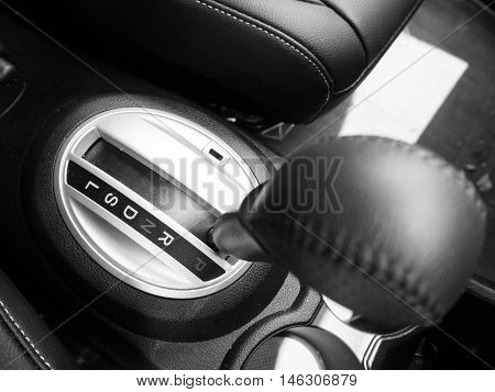 Soft focus at automatic gear shifts left in car