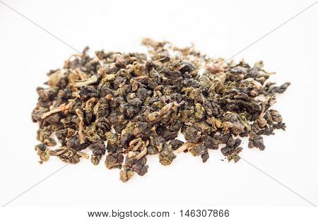 Tea dry leaves on isolated background little
