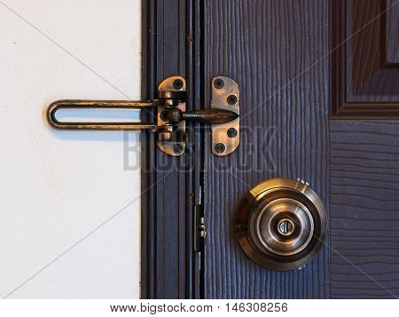 doorknob and bolt or latch with wooden door - security