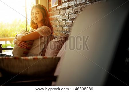 Asia Attractive Woman Sitting On The Couch