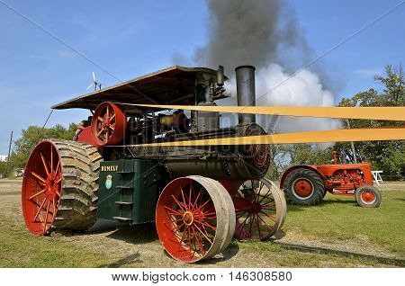 ROLLAG, MINNESOTA, Sept 1. 2016:  A Rumely tractor belches black smoke and steam during the West Central        Steam Threshers Reunion in Rollag, MN.