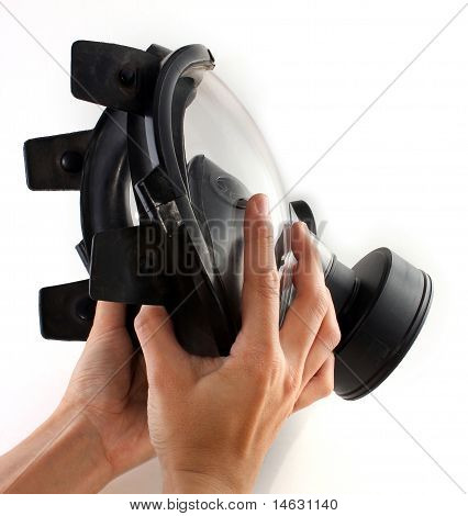 Holding A Black Gas Mask In Hands