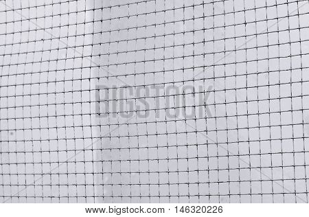 Structure Of Mesh Metal Fence On Dark Cement Wall Background, Black And White Tone
