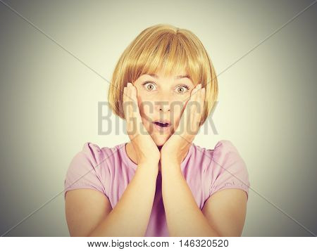 Close-up Portrait Of A Young , Scared Women. She Opened Her Mouth In Surprise.