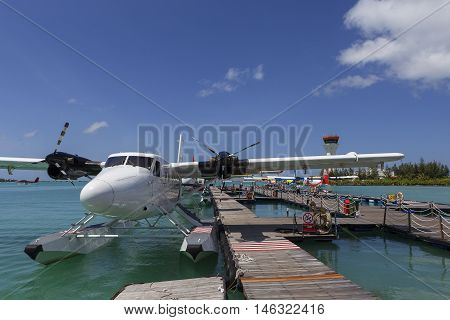 Male Maldives - June 14 2015 : Seaplane harbor of any Maldivian airways operating out of Ibrahim Nasir airport in Male Maldives provides services to several island resorts