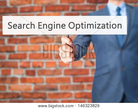 Search Engine Optimization - Business Man Showing Sign