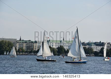 HAMBURG, GERMANY - AUG 26: Sailboats on Lake Alster in Hamburg, Germany, as seen on Aug 26, 2016. Hamburg was founded at the mouth of Alster river in the 9th century and has been used as a port since.