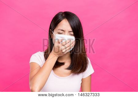 Asian Woman wearing face mask and want to vomit