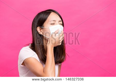 Woman wearing face mask and want to vomit
