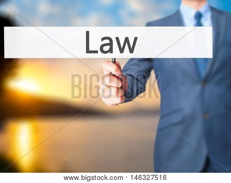 Law - Business Man Showing Sign