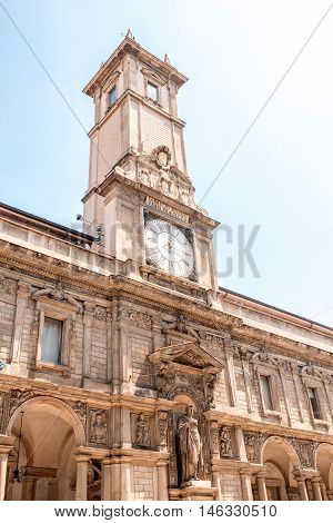 The Giureconsulti palace with clock tower on Mercanti square near Duomo square in Milan city center